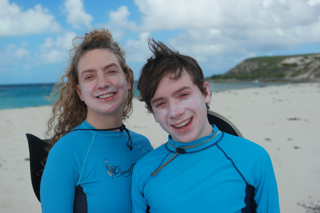 Cynthia & Sean Hoxey donning dive suits--and generous sunblock--prior to exploring the coral reef off Gibb's Cay (Turks & Caicos Islands)